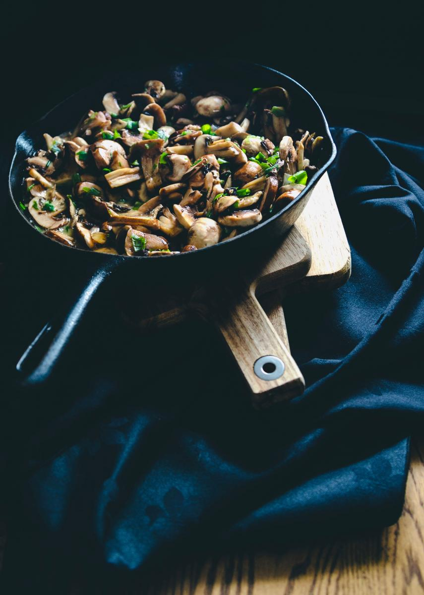 pan with sauteed mushrooms and herbs